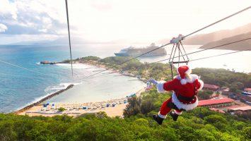 Die Oasis of the Seas bekommt Besuch vom Weihnachtsmann. Er startet auf der Privatinsel Labadee per Zipline. Foto: Royal Caribbean Cruise Line