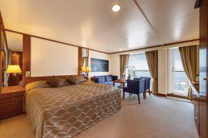 Eine Suite auf der MS Bremen. Foto: Hapag Lloyd Cruises