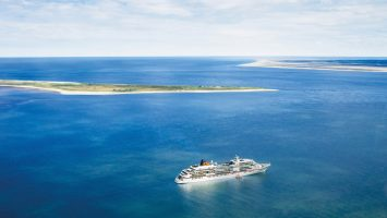 """Zum 15. Mal findet in diesem Jahr die beliebte Partynacht """"MS EUROPA meets Sansibar"""" statt, wenn das Schiff am 28. Juli die Nordseeinsel Sylt anläuft. Foto: Hapag Lloyd Cruises"""