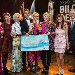 AIDA Präsident Felix Eichhorn (1. v.r.)und Kai Pflaume mit den Preisträgerinnen der Goldenen Bild der Frau. Foto: AIDA Cruises/Ulrich Perrey